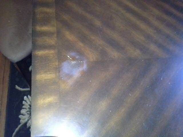 White Spot on a Variegated Wooden Table